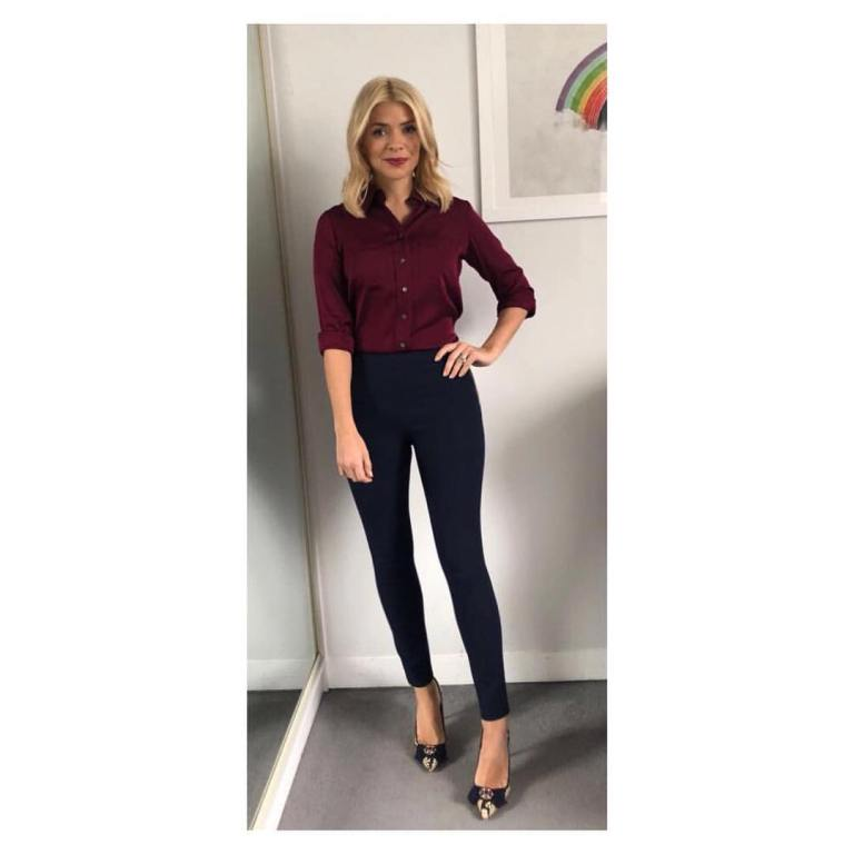 Holly willoughby outfit This Morning wine shirt blue trousers snakeskin bow shoes February 2018