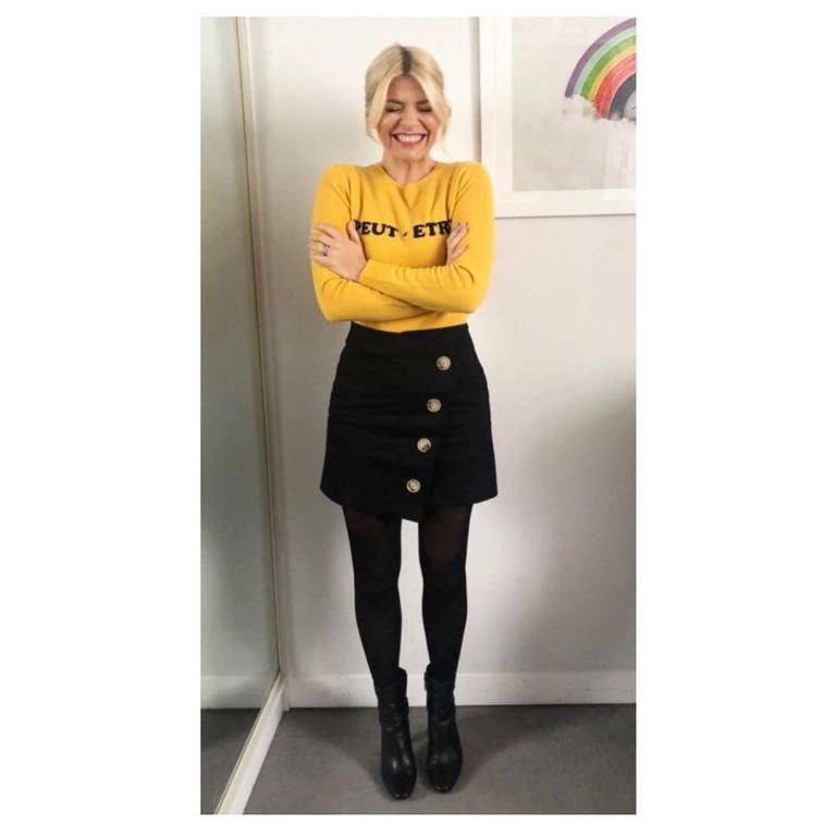 Holly Willoughby This Morning outfit yellow Peut Etre jumper black button skirt black ankle boots February 2018