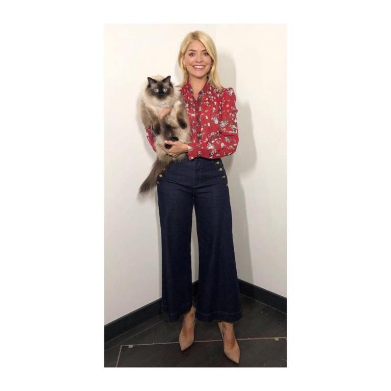 Holly Willoughby this Morning outfit style red floral shirt navy button trousers nude court shoes April 2018