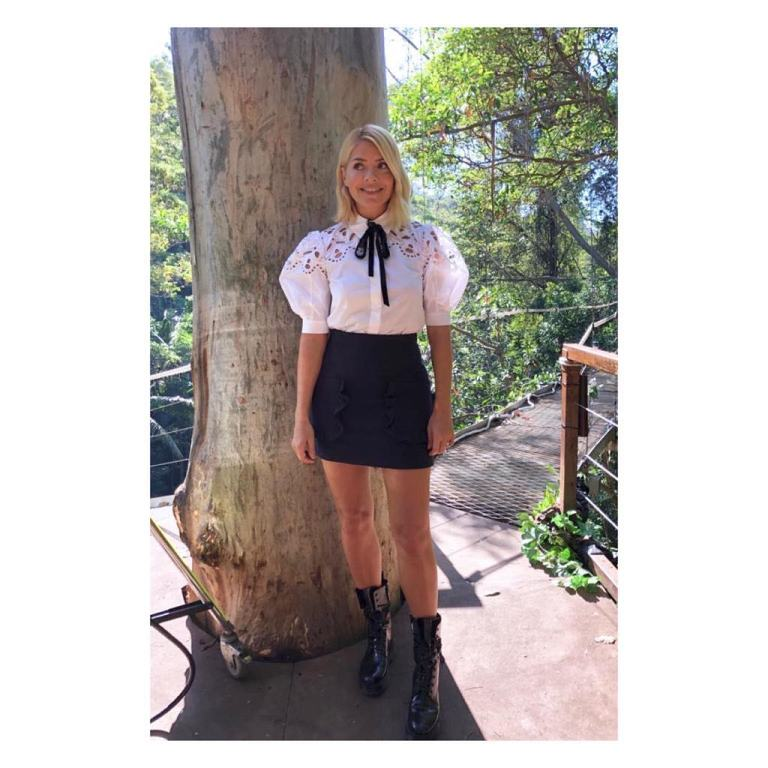 where to get Holly Willoughby white broderie anglaise shirt blue ruffle skirt black boots I'm a Celebrity November 2018