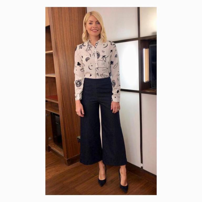 where to get Holly Willoughby This Morning outfit today ivory grphic print shirt blue denim cropped trousers February 2019 photo Holly Willoughby
