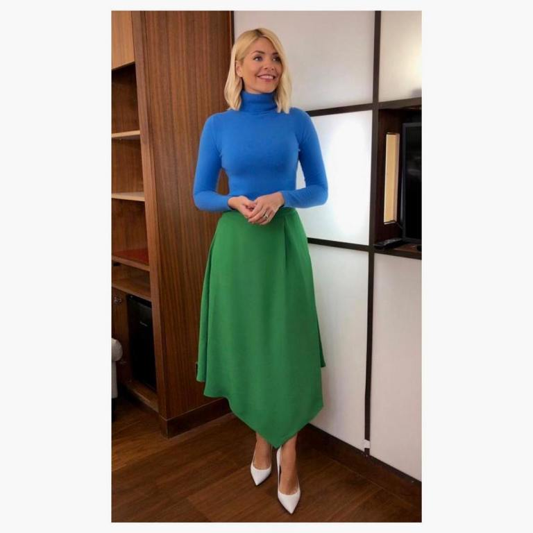 where to get holly willoughby This Morning outfit today green asymmetric midi skirt blue polo neck white court shoes MArch 2019 photo Holly Willoughby