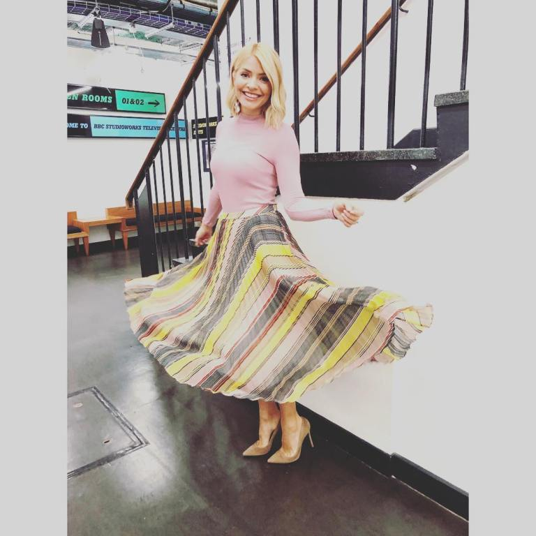 where to get Holly Willoughby This Morning outfit today yellow grey pleated skirt pink top nude court shoes MArch 2019 photo Holly Willoughby