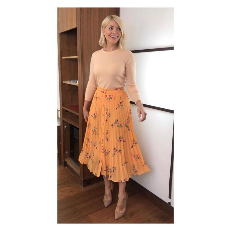 how to find Holly Willoughby This Morning outfit today orange floral pleated skirt peach knit nude suede court shoes June 2019 Photo Holly willoughby