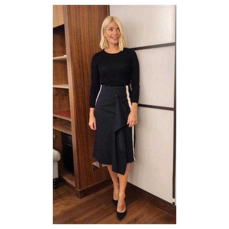 how to find Holly Willougby navy black white stripe skirt black knit black court shoes This Morning outfit September 2019 Photo Holly Willoughby