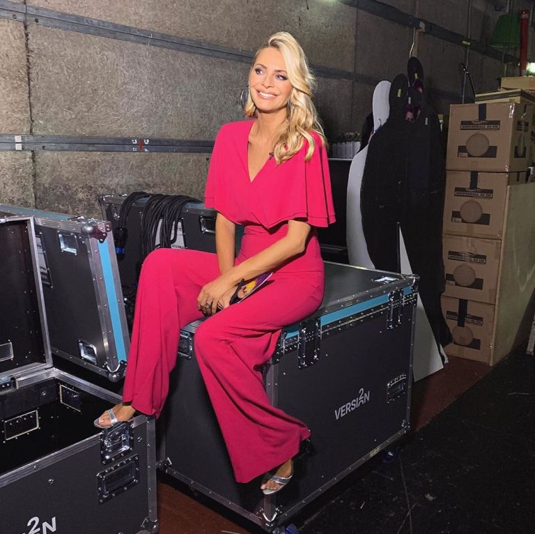 how to find Tess Daly pink cape jumpsuit silver sandals Strictly October 2019 Photo James Yardley
