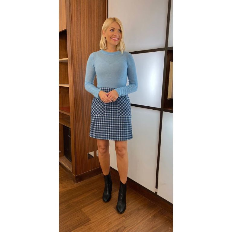 where to get Holly Willoughby blue check skirt blue crew neck jumper black ankle boots This Morning outfit today 26 November 2019 Photo Holly Willoughby
