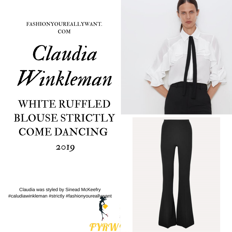 Claudia Winkleman wore This white ruffled blouse with black tie black flared trousers on the Strictly Come Dancing Final 2019 December