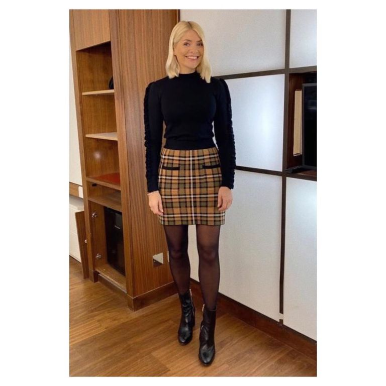 where to get all Holly Willoughby This Morning outfits orange check skirt black knit black ankle boots 21 January 2020 Photo Holly Willoughby