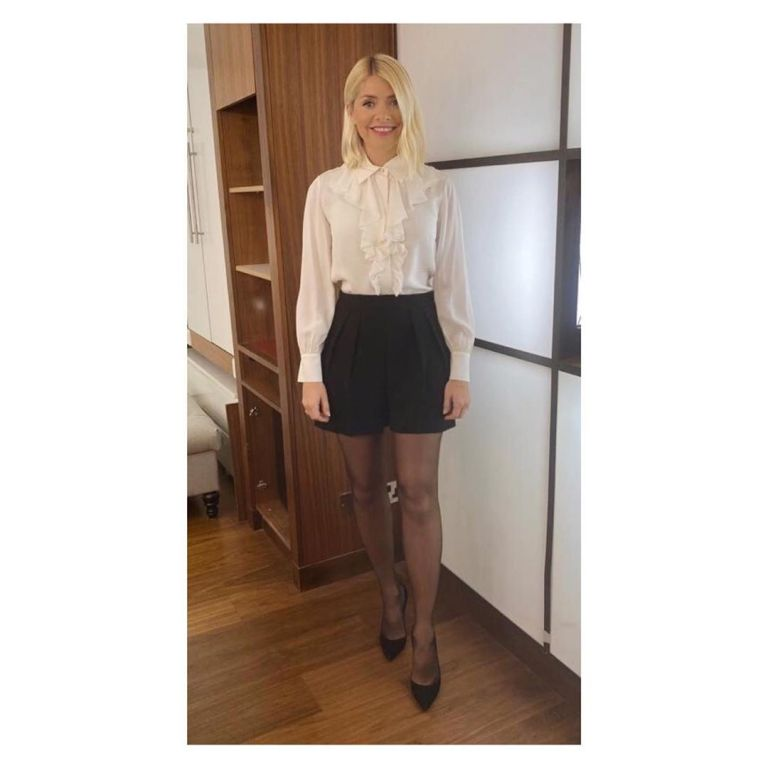 where to get all Holly Willoughy This Morning outfits black pleated shorts cream ruffled blouse 27 January 2020 Photo Holly Willoughby