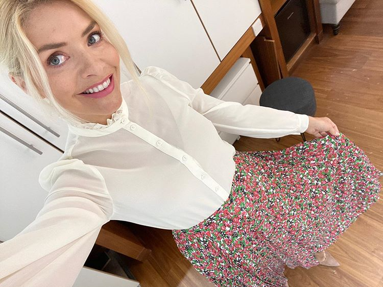 where to get Holly Willoughby This Morning outfit white ruffle neck blouse pink green floral pleated skirt 20 June 2020 Photo Holly Willoughby