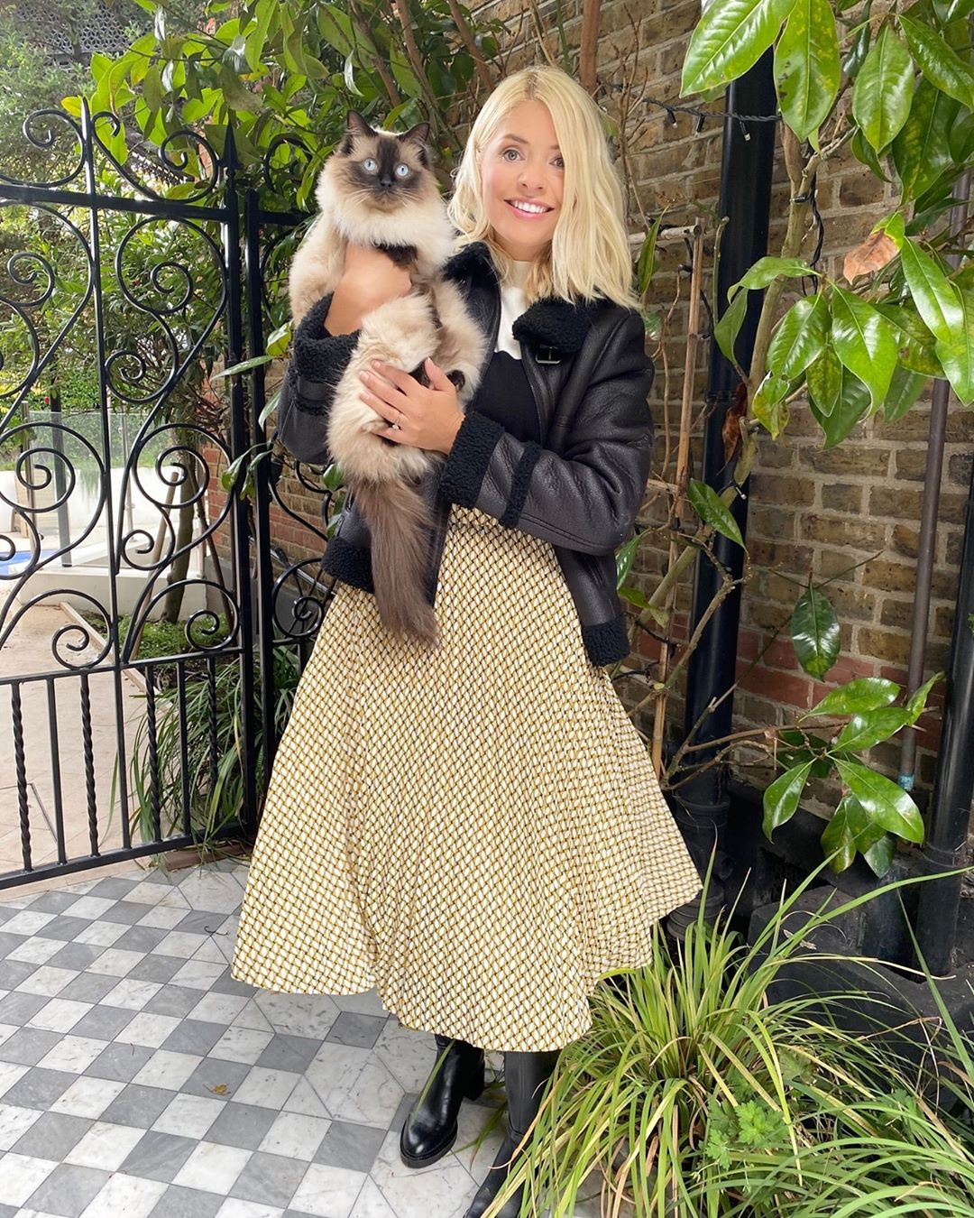 where to get Holly Willoughby shearling jacket geometric print skirt color block jumper 24 September 2020 Photo M&S
