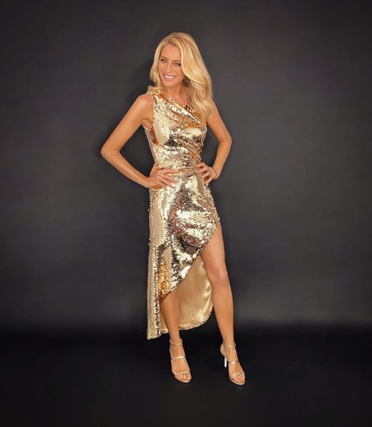 where to get all Tess Daly Strictly dresses silver sequin one shoulder dress silver sandals 19 December 2020 Photo James Yardley