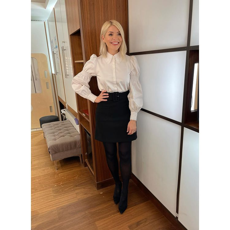 where to get all Holly Willoughby This Morning outfits white lace trim shirt black mini skirt black suede court shoes 7 January 2021 Photo Holly Willoughby