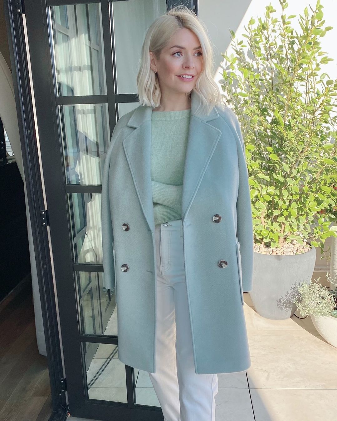 where to get Holly Willoughby apple green coat apple green jumper ecru jeans 28 January 20201 Photo M&S
