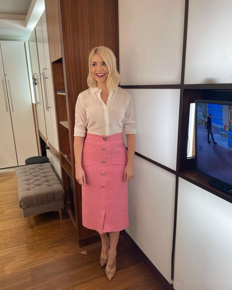 where to get all Holly Willoughby This Morning outfits pink pencil skirt with gold buttons ivory shirt nuded suede court shoes 2 March 2021 Photo Holly Willoughby