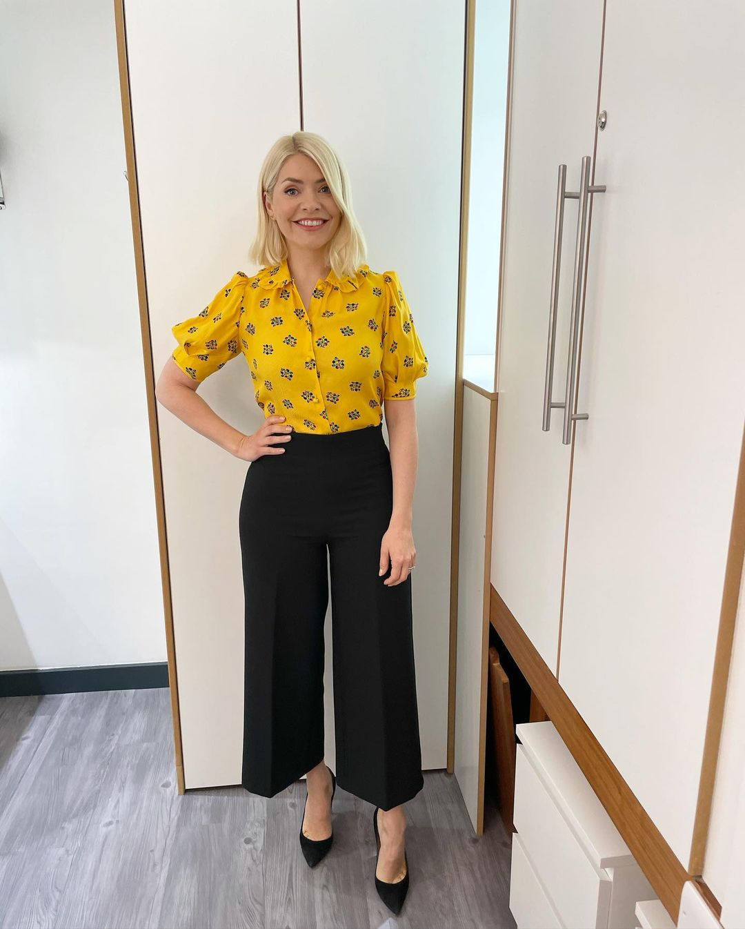 where to get all Holly Willoughby this Morning outfits yellow floral blouse black culottes black suede court shoes 18 May 2021 Photo Holly Willoughby
