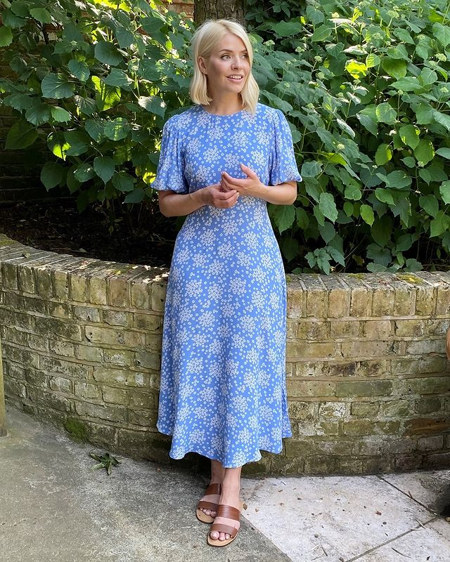 where to get all Holly Willoughby dresses blue and white floral puff sleeve midi dress brown two strap sandals 25 June 2021 Photo M&S
