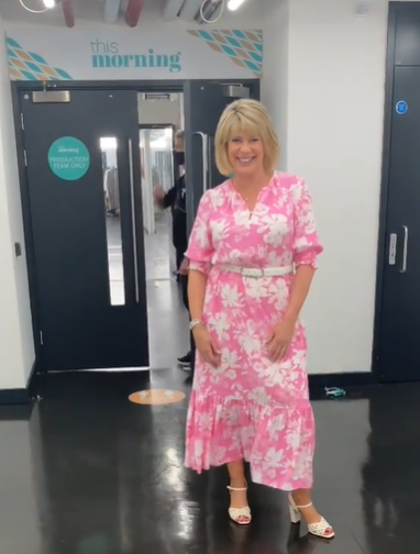 where to get all Ruth Langsford This Morning dresses pink floral midaxi dress white sandals 14 July 2021 Photo Ruth Langsford
