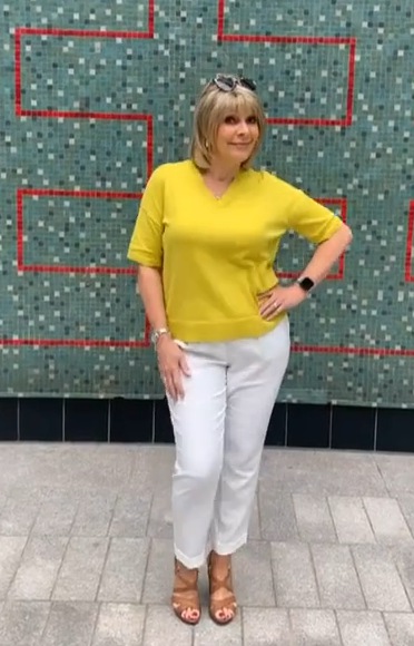 where to get Ruth Langsford This Morning outfits yellow v neck jumper white trousers tan sandals 15 July 2021 Photo Ruth Langsford