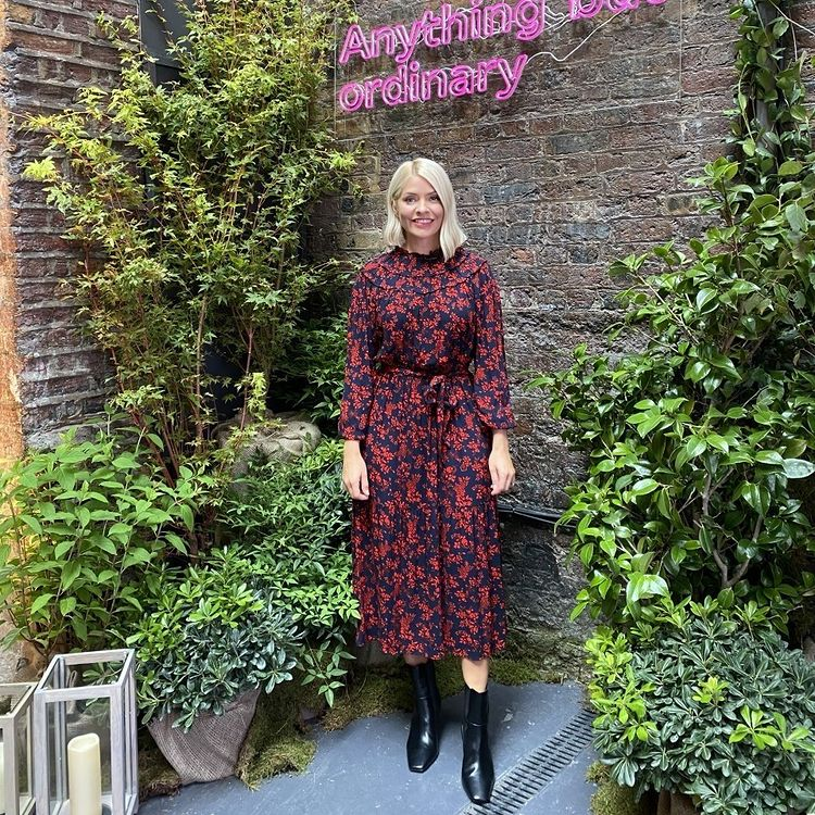 where to get all Holly Willoughby dresses red and black florl long sleeve midi dress black ankle boots Anything But Ordinary 8 September 2021 Photo M&S