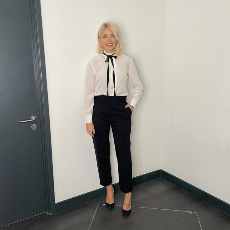 where to get all Holly Willoughby This Morning outfits white ecru blouse with black ribbon black trousers black suede court shoes 7 October 2021 Photo Holly Willoughby